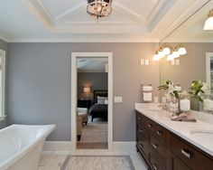 Brown cabinets with grey wall - Benjamin Moore London Fog 1541