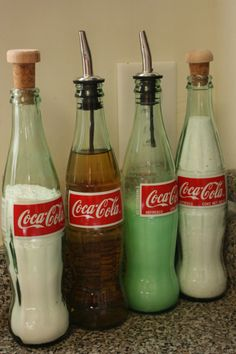 Repurpose coke bottles to hold cooking oils and dish soap.