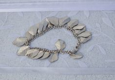 Items similar to Birds of a Feather Bracelet on Etsy Bird Feathers, Birds, Trending Outfits, Unique Jewelry, Bracelets, Handmade Gifts, Silver, Etsy, Vintage