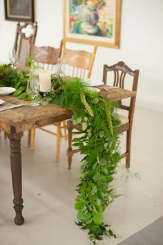 cascading garland on head table / http://www.himisspuff.com/wedding-table-centerpieces-runners/2/
