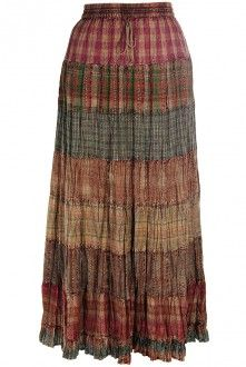"Ruffled hem tiered skirt ~ Comfortable, breathable cotton in a long modest broomstick style, this skirt falls from the fully elasticized waistband in seven 5"" tiers and is finished by a 2.5"" ruffle around the hemline. The colors are muted earth tones of browns, reds, greens, oranges promoting many options for coordinating."