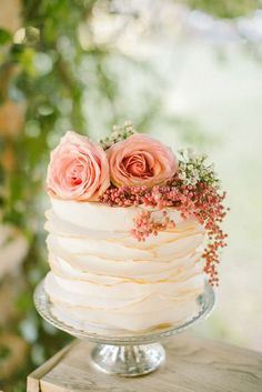 A gorgeous mini textured cake with flowers. Source: annaroussos.com #weddingcakes