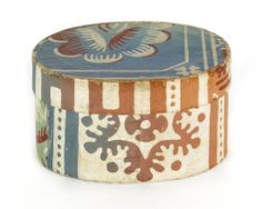 "Oval wallpaper box, 19th c., with floral decoration on a blue and green ground, 2 1/2"" h., 4 5/8"" w."