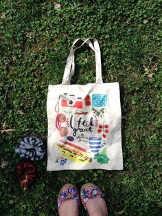 Summer bag made of rain-coat fabric with print. Size 39x44 cm, handles 60 cm. It has small pocket inside.