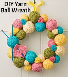Create the perfect crafter's wreath! Check out this tutorial for How To Make A Yarn Ball Wreath! | DIY Wreath