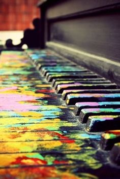 old piano with splatter-painted keys