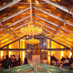 Brides.com: An Eclectic Black-Tie Wedding in San Francisco, California. Chandeliers and candles gave the tent a warm glow.