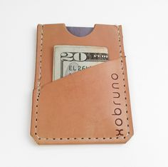 It's true. It's the smallest wallet.  Made with vegetable tanned leather & hand finished with carnauba wax. Two pockets for cards and cash. FITS ANYWHERE  2 3/4 x 3 3/4  Handmade in Portland Oregon USA