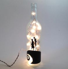 Recycled wine bottle made into a lamp with the romantic Jack and Sally scene from Nightmare Before Christmas on the front. This light makes a great decoration for any home or dorm and a great anniversary, wedding, birthday, graduation or holiday gift! This is a small (regular size),