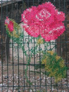 Amazing street art on chicken wire and railings fence of a beautiful rose crochet lace worl or just weaving a very sophisticated form of yarn bombing or a romantic cross stitch style paint job Yarn Bombing, Graffiti, Cross Stitching, Cross Stitch Embroidery, Guerilla Knitting, Street Art, Urbane Kunst, Posters Vintage, Fence Art