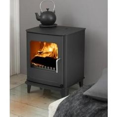 Morso Stoves - Quality, Danish Wood-burning and Multi-Fuel Stoves. Buy your Morso Stove from Authorised UK retailer. Morso Wood Stove, Morso Stoves, Wood Stoves, Contemporary Wood Burning Stoves, Multi Fuel Stove, Grey Lounge, Wood Burner, Sophisticated Style, Hearth