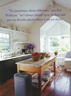 Gable kitchen w/ ironstone, old floorboards, and double sinks; Peri Wolfman