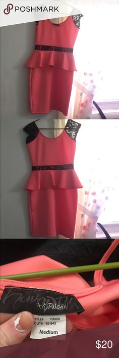 Coral peplum dress Coral peplum dress with black lace.. has a tiny poke in fabric as seen in last picture Dresses Midi