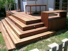 Low deck stairs and raised bench to replace concrete front step.