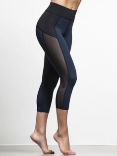 These Michi capris show seduction doesn't have to be an all-black affair: their rich blue fabric gives you a burst of color that's still totally grown-up. The semi-sheer mesh panels are classic Michi—they slim your silhouette, cool you down, and make you the foxiest girl in the room.