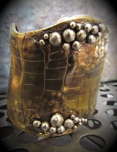 Python Print Cuff. $215.00, via Etsy...OMG, I love this............too bad  can't afford it.