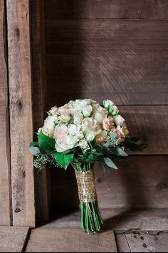 Sparkly gold wrapped wedding bouquet.