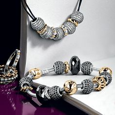 Pandora black and gold bracelet idea