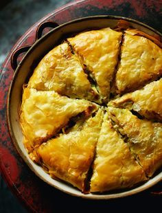 The Greeks love their pies almost as much as we or the Aussies do, but theirs are made by building up thin sheets of filo pastry. This chicken pie was sensational, made by a mother-and-daughter team, Iro and Virginia Papapostolu, in the village of Aspragg Greek Dishes, Main Dishes, Quiches, Stuffed Whole Chicken, Greek Recipes, Turkish Food Recipes, Mediterranean Recipes, International Recipes, Food Dishes