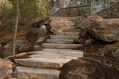 """Often the local Muskoka Landscape can be a challenge to work around. This project utilized 3"""" oversized flagstone combined with natural faced granite treads to make the most of a challenging work site. When working on a site with bedrock just inchescalibration of Muskoka Rock Company's granite flagstone and stair treads made this project a home run."""
