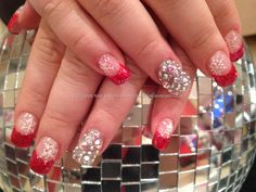 Swarovski crystal ring fingers with red glitter tips and freehand snowflake nail art
