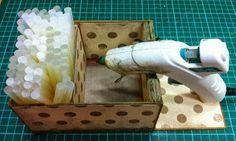 Hot Glue Gun Stand- Good idea to have your glue sticks with the glue gun.