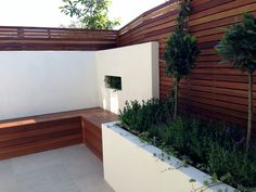 small modern minimalist low maintenance garden dulwich london block wall bench hardwood screen trellis privacy screen architectural planting (12)