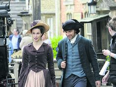 Heida Reed and Aidan Turner on set 6 May 2014 in Corsham via www.gazetteandherald.co.uk/news/towns/corshamheadlines/11194579.Brooding_looks_from_star_Aidan_as_Poldark_comes_to_Corsham/?ref=twtrec