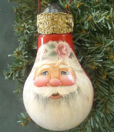 Santa Claus Christmas Ornament in Red on Recycled Light Bulb  by BrushedByAnAngel.  Her Hand-painted Santa is beautiful!