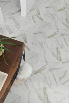 Now available in stores, our new Carrara luxury vinyl sheet pattern features a marble hexagon, giving it a trendy update on a classic style. This incredibly realistic visual is sure to add to your home. Shown in Color: Pearl. Tile Inspiration, Stylish Living Room, Wood Vinyl, Vinyl Sheets, Vinyl, Flooring, Luxury Sheets, Dining Room Spaces, Vinyl Flooring