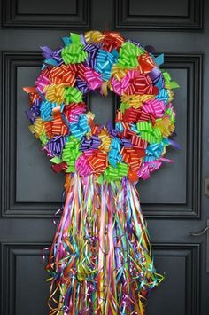 This fun and festive wreath features brightly colored waterproof/weatherproof ribbon bows on a grapevine wreath base adorned with an abundance of streaming ribbons! Finished wreath depending on the size chosen can measure approximately or Valentine Day Wreaths, Christmas Wreaths, Birthday Wreaths, Halloween Christmas, Christmas Parol, Wreaths For Front Door, Door Wreaths, Baby Wreaths, Summer Wreath