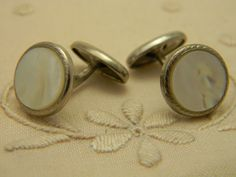 Vintage Mother of Pearl silver tone cuff links.
