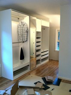 IKEA Pax wardrobes- in the entry and mud area? With doors of course.