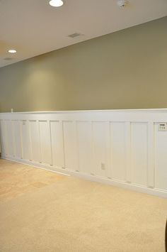 I like the molding around the bottom and the recessed lighting - great idea for our basement!