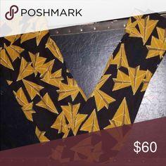 LulaRoe TC Paper Airplanes Mustard Leggings NEW NEW UNICORN LEGGINGS PRINT... Mustard Yellow Back Background. Pet Free and Smoke Free Home. Fast Shipping LuLaRoe Pants Leggings