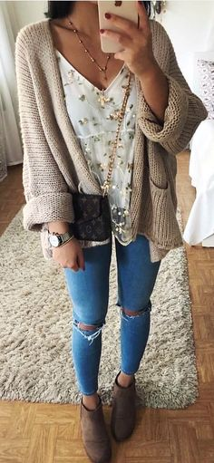 #winter #outfits  brown knitted cardigan and distressed blue denim pants
