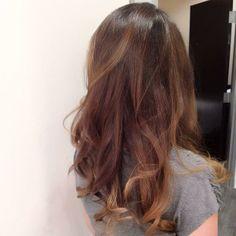 Long rich brunette hair with her tips lightened
