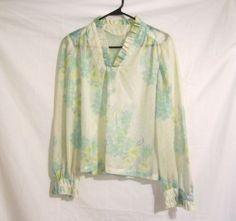 Vintage Floral Womens Pastel Sheer 1970s Ruffled Top. $12.00, via Etsy.