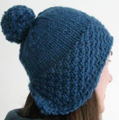 Here's a hat that covers your ears and looks adorable. The Pompom Hat is made with chunky yarn so that your head stays cozy warm. The dimensions are made to fit the average lady's head, but are also the perfect design for men as well.