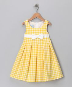 A sunny color, a peppering of pleats and an easy-on back zipper combine to make one perfect playtime piece. With a swing silhouette and a crisp white bow, this dress is so sweet, there's no need for dessert. 100% cottonMachine wash; hang dryMade in El Salvador