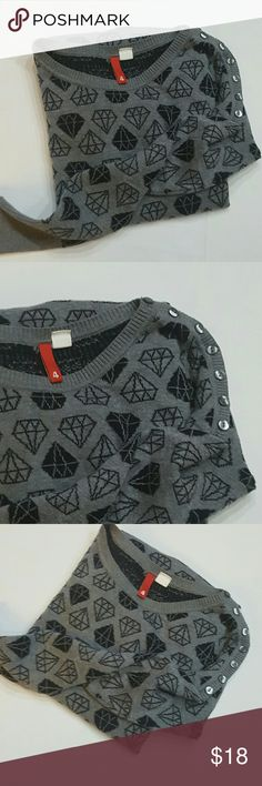 H&M long sweater H&M long sweater diamond print buttons down 1 sleeve only. In perfect condition H&M Sweaters