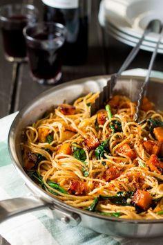 pumpkin spinach walnut spaghetti in a pan