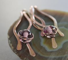 This really beautiful copper earrings made with hand forged wavy hammered sticks accented with wrapped amethyst color lampwork glass beads (5x9mm in size) suspended from lever back earwires (nickel and lead free). Please see last image for color selection. The earrings are 3(7.5cm) in length in total. Please see a matching necklace here. https://www.etsy.com/listing/163142344/wavy-fringe-copper-necklace-with?ref=shop_home_feat   ★ ★ ★ ★ ★ ★ ★ ★ ★ Enter my shop here…