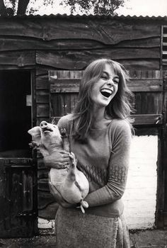 Happy Jean Shrimpton with piglet. Photo by David Hurn, 1966.