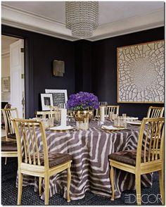 Love. Chandelier, art work, dark walls, zebra print table cloth, blue flowers, gold :) Aerin Lauder again...