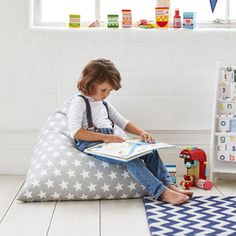 The pyramid style supports your children at the back. Better for posture and better for reading too.