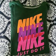 Nike women's slim fit shirt Dark green Nike slim fit shirt with with bright Nike down the front.  Short sleeved.  Never worn, washed and dried ONCE.....now fits like a MEDIUM imo....so it no longer fits:(  may fit a large if you prefer your shirts tight. Nike Tops Tees - Short Sleeve