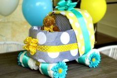 A baby carriage diaper cake is made almost entirely of diapers and blankets, so after the shower, the carriage can be taken apart to use.