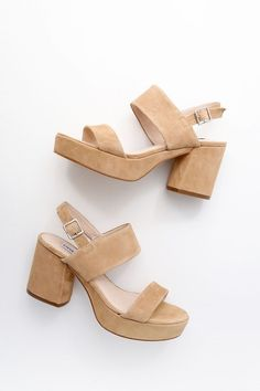 """The Steve Madden Reba Tan Suede Leather Platform Sandals are giving us all the retro vibes we love! Ultra-soft genuine suede shapes a peep toe upper, strappy vamp, and adjustable slingback strap (with silver buckle). 1"""" toe platform."""