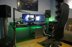 Previous user EX1ST has an updated picture on his battlestation. That green glow... something about it just makes me feel awesome. Markus chair from IKEA is comfortable too.